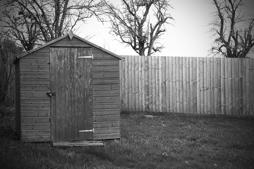 A black and white photo of the shed that houses the wellhead at Hillside Brewery in Longhope, Forest of Dean.