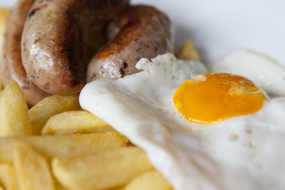 Sausages from Sharon's pigs, perfectly cooked chips and a fried egg!