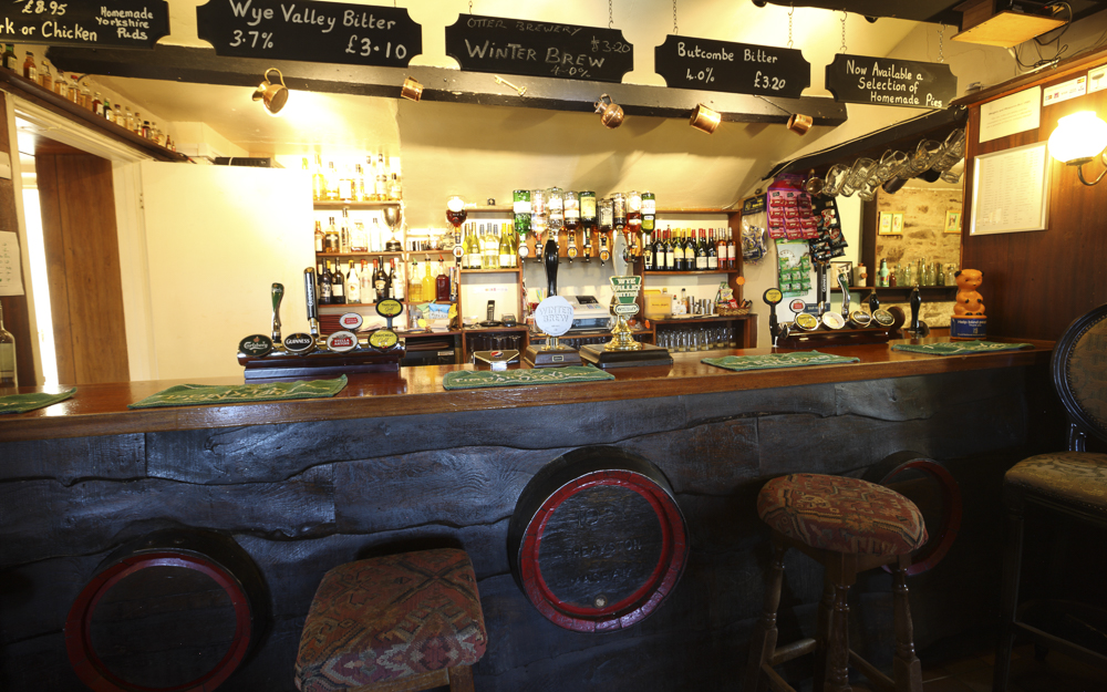 Inside The Rising Sun, a traditional pub with wooden fixtures