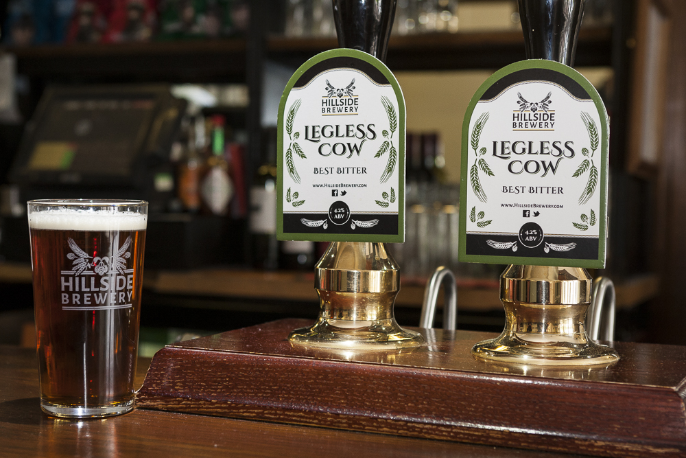 Peter Hands of The Speech House Hotel takes delivery of Hillside Brewery Legless Cow ale, by Paul Williamson.