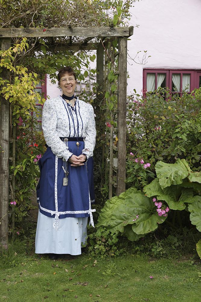 Aunt Martha standing in her garden