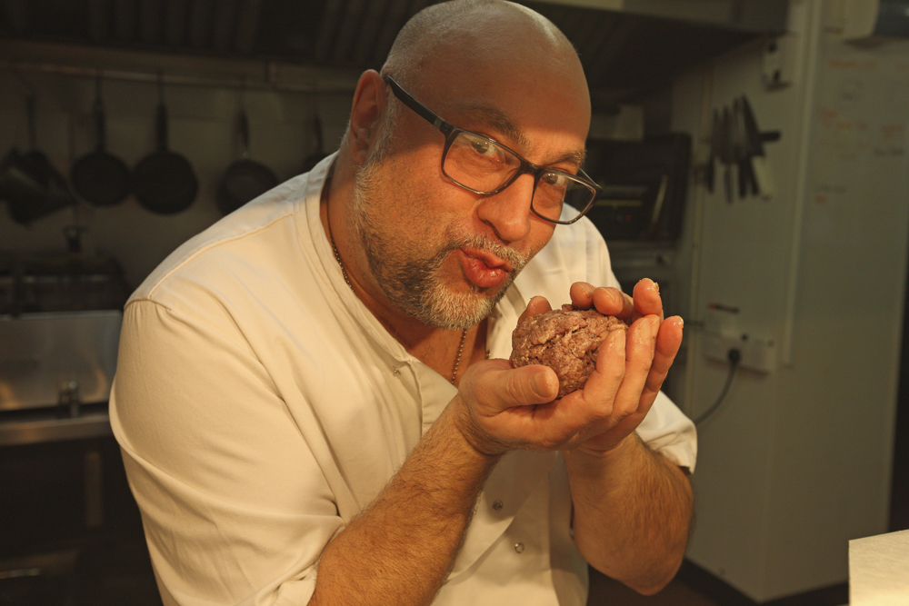 Mario - Owner of the Miners Arms, Whitecroft, posing for the camera whilst making his Scotch eggs.