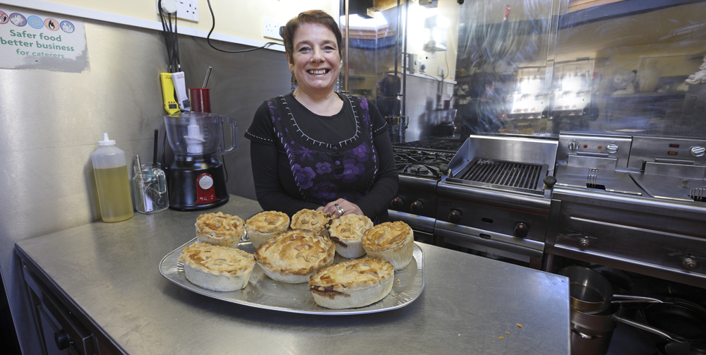 Maria, Landlady at The Rising Sun, Woolaston Common, in the kitchen standing over her homemade pies