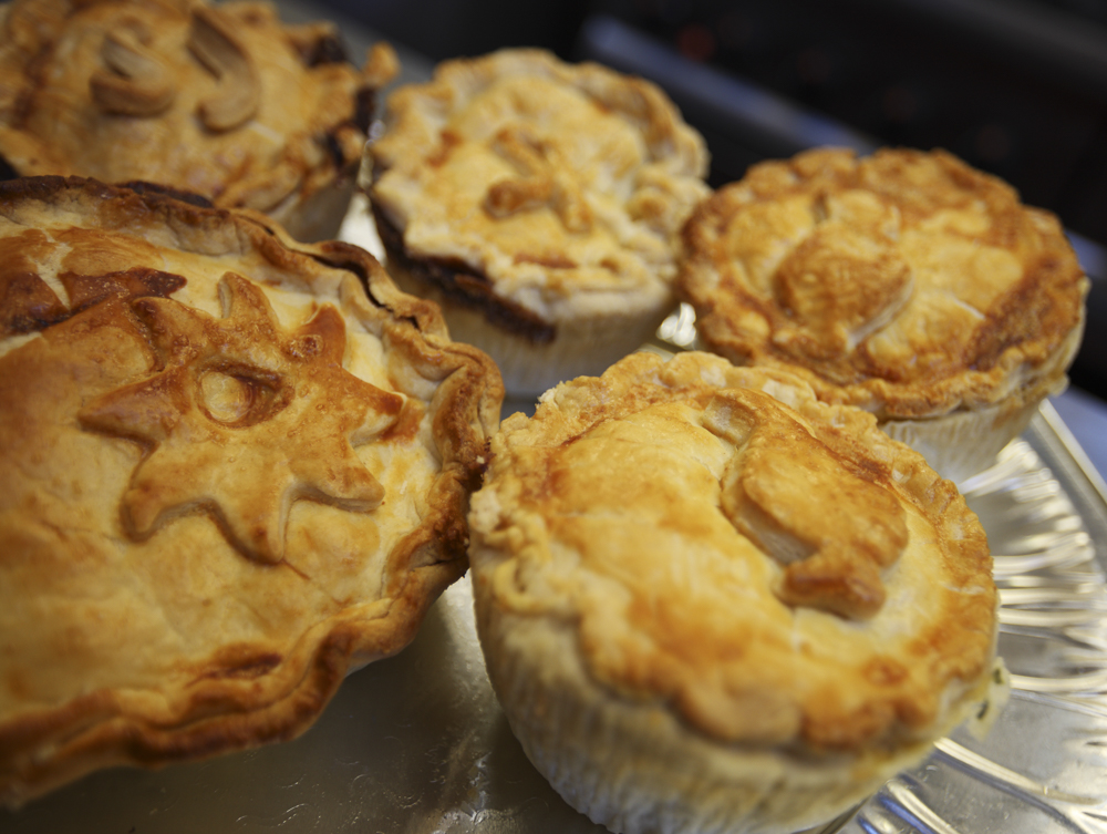 A plate of Maria's homemade pies, looking delicious!